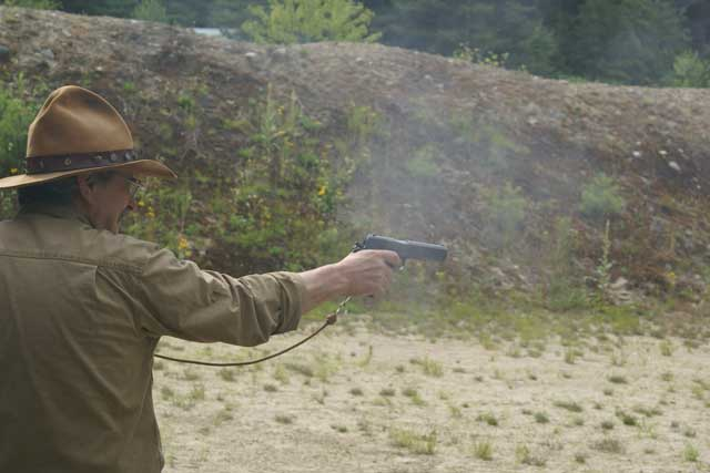 ... and shooting his 1911 pistol.